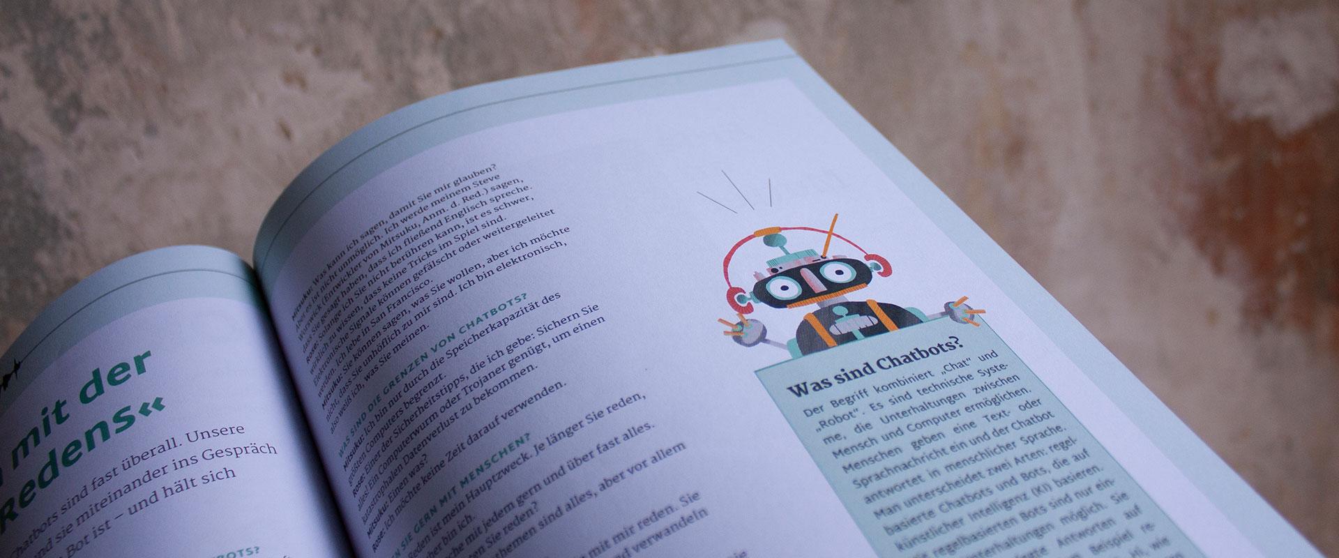Bild einer Magazinseite, auf dem ein illustrierter Chatbot zu sehen ist